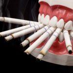 Имплантация зубов: можно ли курить?